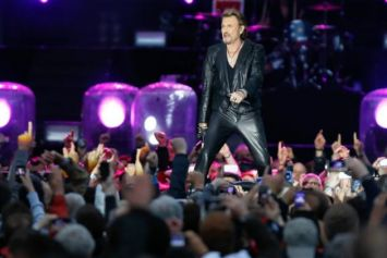 Le chanteur Johnny Hallyday lors d'un concert à Namur, le 23 juin 2013. [Photo: AFP]