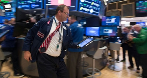 Traders sur le parquet du New York Stock Exchange le 1er novembre 2017 à New York