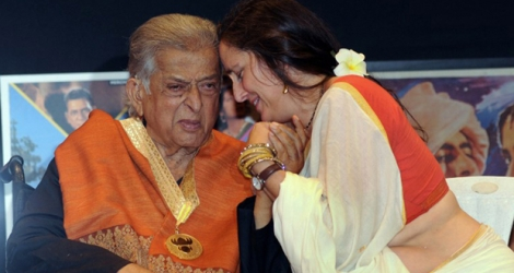 Indian veteran Bollywood actor Shashi Kapoor (L) and his daughter Sanjana Kapoor interacting during the presentation of the 'Dadasaheb Phalke Award' for his contribution to Indian cinema at Prithvi Theater in Mumbai.