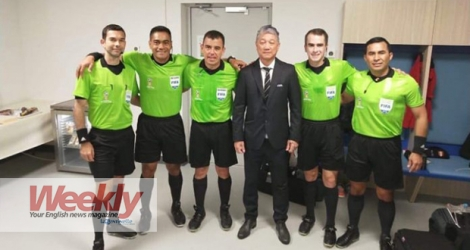 Alain Lim Kee Cheong (middle) with match officials for Sweden vs. South Korea.