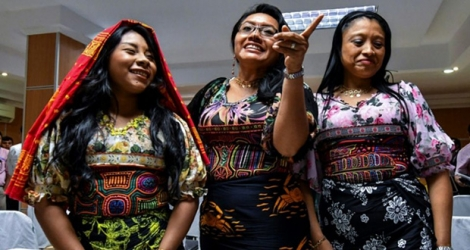 Guna indigenous women from Panama wearing traditional Mola designs at a press conference in Panama City to raise awareness of their intellectual property case against US Sportswear giant Nike.