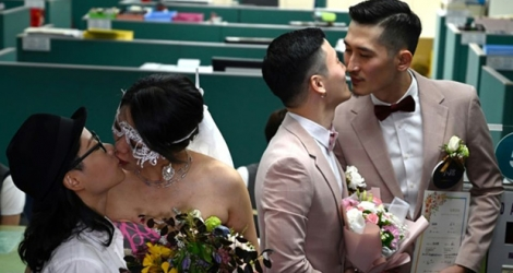 The first couples to marry embraced and kissed after receiving their marriage certificates.