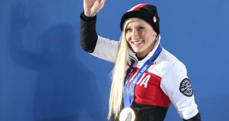 La Canadienne Kaillie Humphries remporte l'or en bobsleigh à Sochi le 20 février 2014.