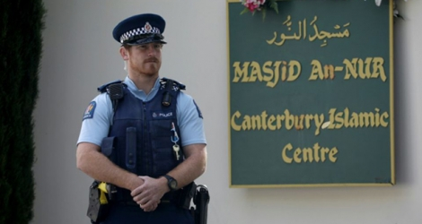 A police officer stands guard outside the Al Noor mosque ahead of the first anniversary of the Christchurch mosque shootings in Christchurch in March 2020.