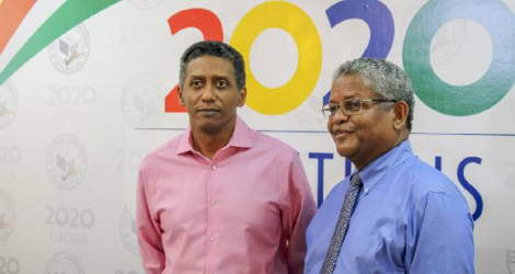 Outgoing Seychelles president Danny Faure (left) with newly-elected President Wavel Ramkalawan.